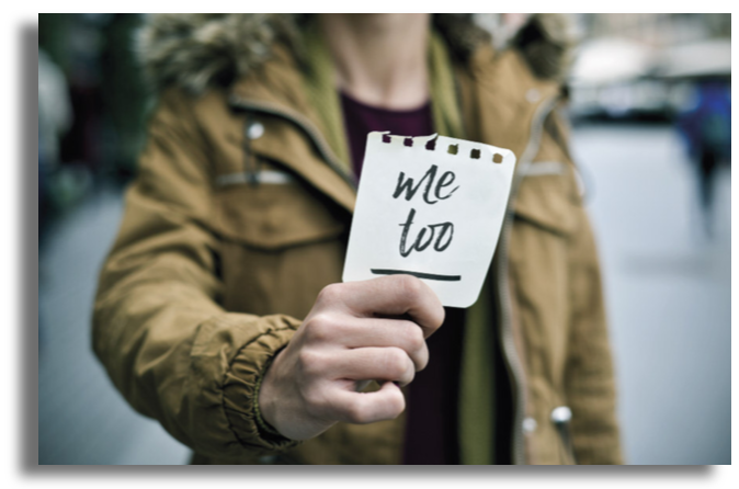Person holding Me Too sign